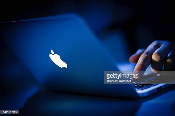 In this photo Illustration the logo of Apple lights on an Apple Macbook Air on June 22 2016 in Berlin Germany