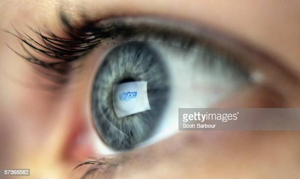 In this photo illustration the logo of the internet communications company Skype is reflected in the eye of a woman looking at a computer screen...