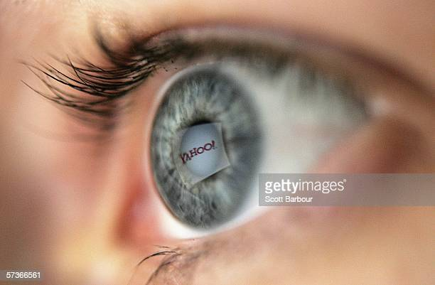 In this photo illustration the logo of the multifacetted internet giant Yahoo is reflected in the eye of a woman looking at a computer screen April...