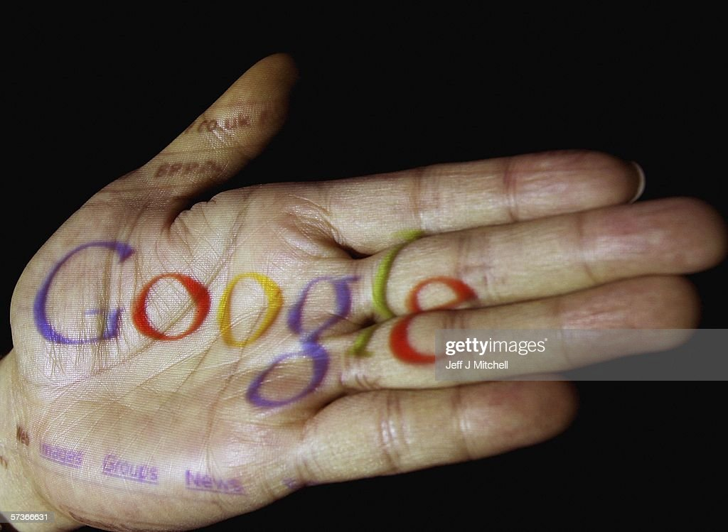 In this photo illustration, the logo of the multi-facetted internet giant Google is seen projected onto the palm of a hand on April 12, 2006, in Glasgow, Scotland.