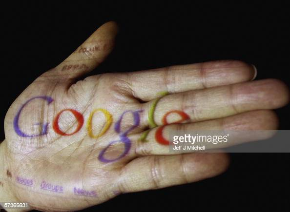 In this photo illustration the logo of the multifacetted internet giant Google is seen projected onto the palm of a hand on April 12 in Glasgow...
