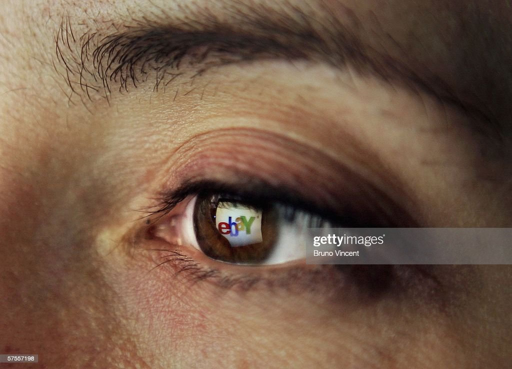 In this photo illustration the logo of the multi-facetted internet auction site Ebay is reflected in the eye of a woman, May 8, 2006 in London, England.