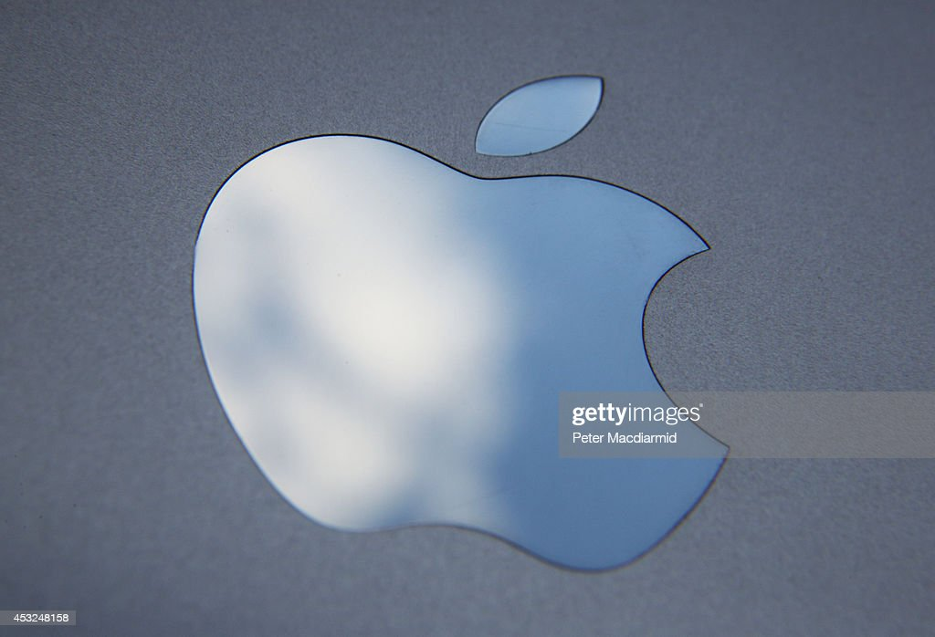 In this photo illustration the logo on an Apple iPad is seen on August 6 2014 in London England iPad maker Apple is selling fewer units than in the...