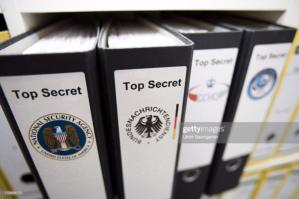 In this photo illustration, the logos of intelligence agencies (L-R) NSA (National Security Agency, USA ), BND (Bundesnachrichtendienst, Germany ), GCHQ (Gouverment Communications Headquarters, Great Britain) and DGSE (Direction Generale de la Securite Exterieur, France) are displayed on folders on July 15, 2013 in Bonn, Germany. It has been reported that Germany's federal intelligence agency (BND) knew about U.S. surveillance and stored communications by German citizens, and has accessed this data in recent years to help with German nationals abducted abroad.