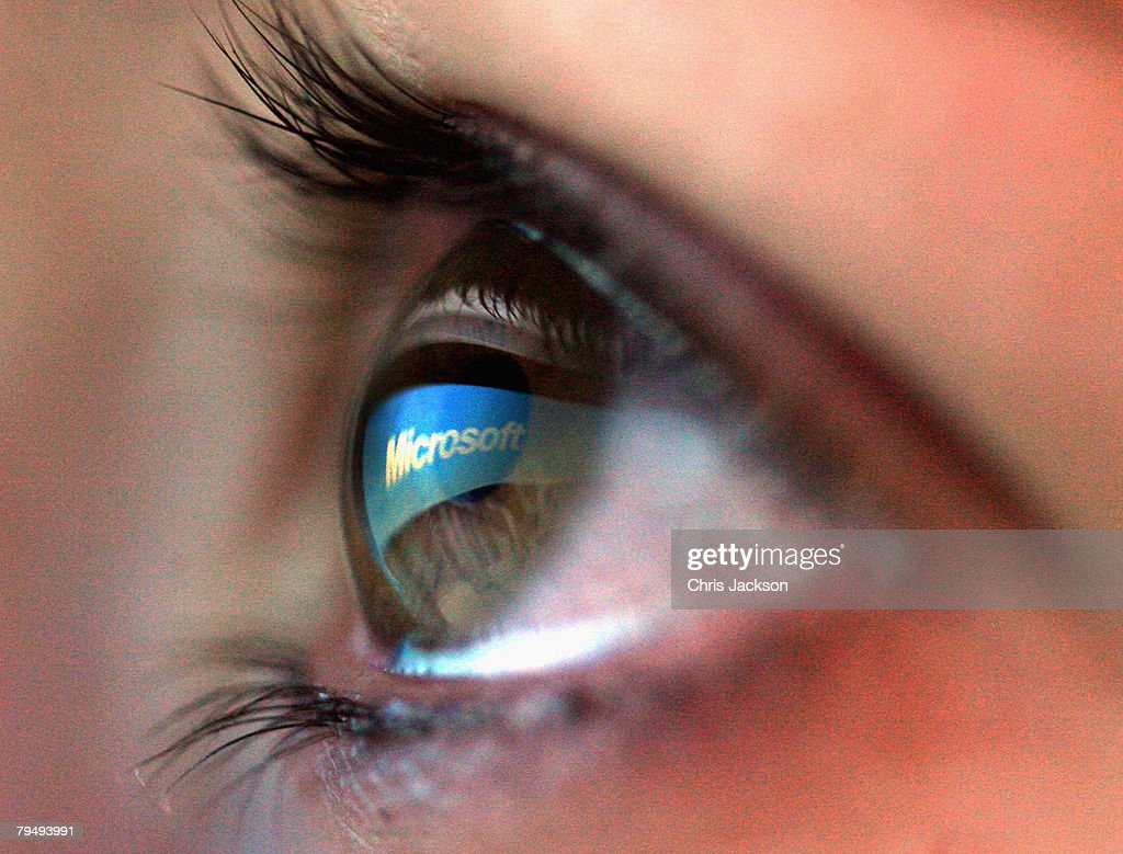 In this photo illustration the Microsoft logo is reflected in the eye of a girl on February 3, 2008 in London, England. Financial experts continue to evaluate the recent Microsoft $44.6 billion (?22.4 billion) offer for Yahoo and the possible impact on Internet market currently dominated by Google.