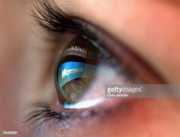 In this photo illustration the Microsoft logo is reflected in the eye of a girl on February 3 2008 in London England Financial experts continue to...