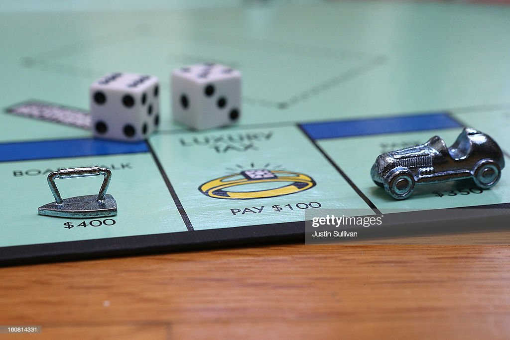 In this photo illustration, The Monopoly iron and race car game pieces are displayed on February 6, 2013 in Fairfax, California. Toy maker Hasbro, Inc. announced today that fans of the board game Monopoly voted in an online contest to eliminate the iron playing figure and replace it with a cat figure. The cat game piece received 31 percent of the online votes to beat out four other contenders, a robot, diamond ring, helicopter and guitar.