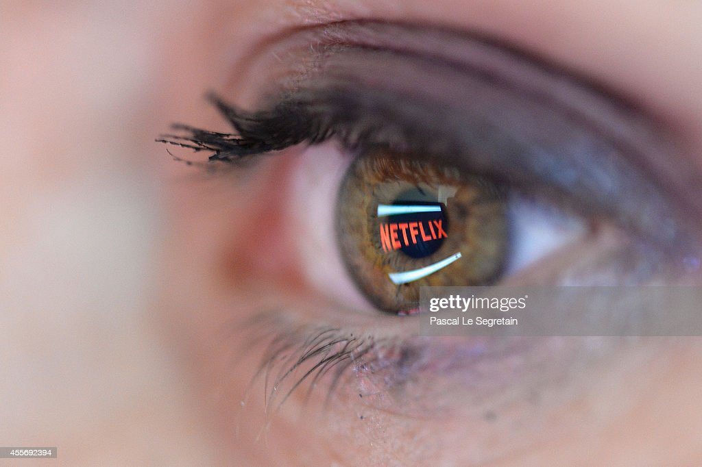 In this photo illustration the Netflix logo is reflected in the eye of a woman on September 19 2014 in Paris France Netflix September 15 launched...