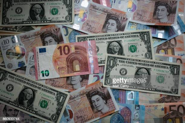 In this photo illustration the new £10 note is seen alongside euro notes and US dollar bills on October 13 2017 in Bath England Currency experts have...