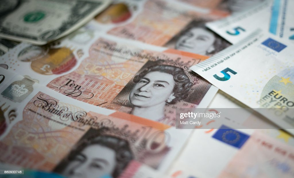 In this photo illustration, the new £10 note is seen alongside euro notes and US dollar bills on October 13, 2017 in Bath, England. Currency experts have warned that as the uncertainty surrounding Brexit continues, the value of the British pound, which has remained depressed against the US dollar and the euro since the UK voted to leave in the EU referendum, is likely to fluctuate.