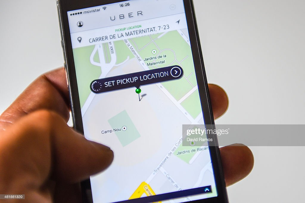 In this photo illustration, the new smart phone app 'Uber' shows how to select a pick up location at the Camp Nou Stadium on July 1, 2014 in Barcelona, Spain. Taxi drivers in main cities strike over unlicensed car-halling services. Drivers say that is a lack of regulation behind the new app.