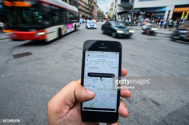 In this photo illustration the new smart phone taxi app 'Uber' shows how to select a pick up location on July 1 2014 in Barcelona Spain Taxi drivers...