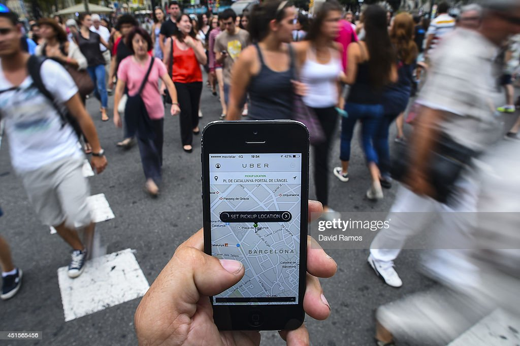 In this photo illustration the new smart phone taxi app 'Uber' shows how to select a pick up location at Plaza de Catalunya square on July 1, 2014 in Barcelona, Spain. Taxi drivers in various cities have been on strike over unlicensed car-hailing services. Drivers say that there is a lack of regulation behind the new app.