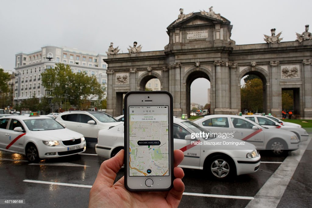 In this photo illustration the new smart phone taxi app 'Uber' shows how to select a pick up location at Puerta de Alcala Square on October 14, 2014 in Madrid, Spain. 'Uber' application started to operate in Madrid last September despite Taxi drivers claim it is an illegal activity and its drivers currently operate without a license. 'Uber' is an American based company which is quickly expanding to some of the main cities from around the world.