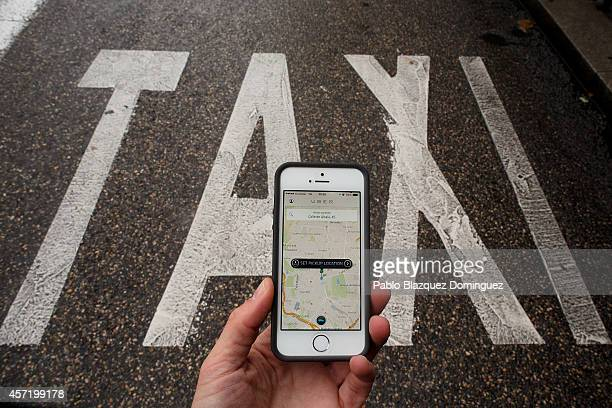 In this photo illustration the new smart phone taxi app 'Uber' shows how to select a pick up location next to a taxi lane on October 14 2014 in...