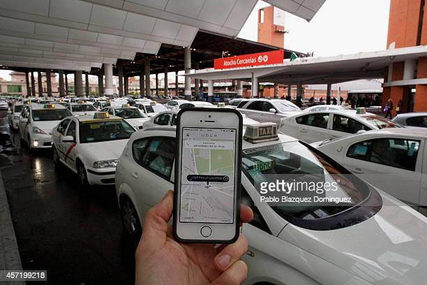 In this photo illustration the new smart phone taxi app 'Uber' shows how to select a pick up location at Atocha Station on October 14 2014 in Madrid...