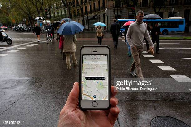 In this photo illustration the new smart phone taxi app 'Uber' shows how to select a pick up location at Puerta de Alcala Square on October 14 2014...