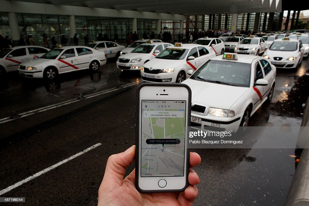 In this photo illustration the new smart phone taxi app 'Uber' shows how to select a pick up location at Atocha Station on October 14, 2014 in Madrid, Spain. 'Uber' application started to operate in Madrid last September despite Taxi drivers claim it is an illegal activity and its drivers currently operate without a license. 'Uber' is an American based company which is quickly expanding to some of the main cities from around the world.