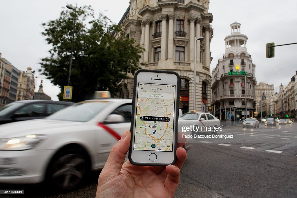 In this photo illustration the new smart phone taxi app 'Uber' shows how to select a pick up location at Alcala Street on October 14, 2014 in Madrid, Spain. 'Uber' application started to operate in Madrid last September despite Taxi drivers claim it is an illegal activity and its drivers currently operate without a license. 'Uber' is an American based company which is quickly expanding to some of the main cities from around the world.