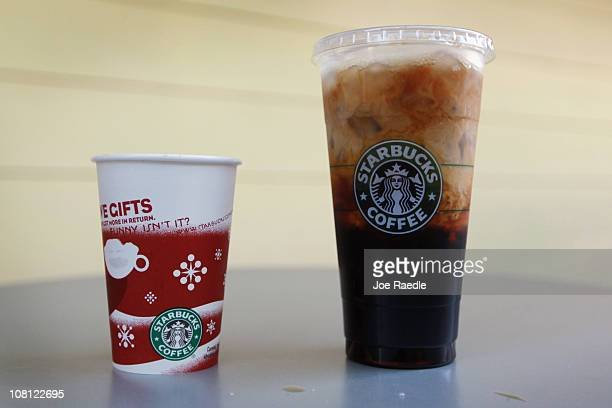 In this photo illustration the new Starbucks 31ounce Trenta size ice coffee is seen on the right next to a tall cup of Starbucks coffee on January 18...