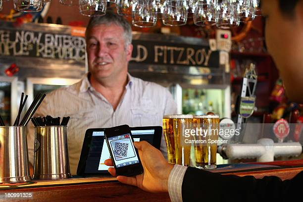 In this photo illustration The Old Fitzroy Pub owner Garry Pasfield serves a customer using bitcoins on September 19 2013 in Sydney Australia The Old...