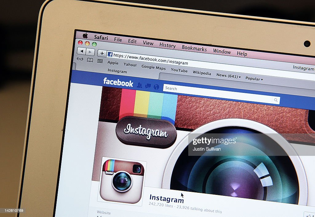In this photo illustration the photosharing app Instagram fan page is seen on the Facebook website on the Apple Safari web browser on April 9 2012 in...