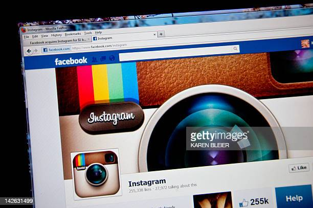 In this photo illustration the photosharing app Instagram fan page is seen on the Facebook website on the Firefox web browser on April 10 2012 in...