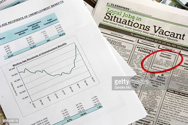 In this photo illustration the rise in unemployment is shown in a graph alongside job vacancies in the newspaper on August 7 2009 in Auckland New...
