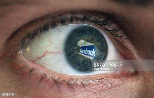 In this photo illustration the Social networking site Facebook is reflected in the eye of a man on March 25 2009 in London England The British...