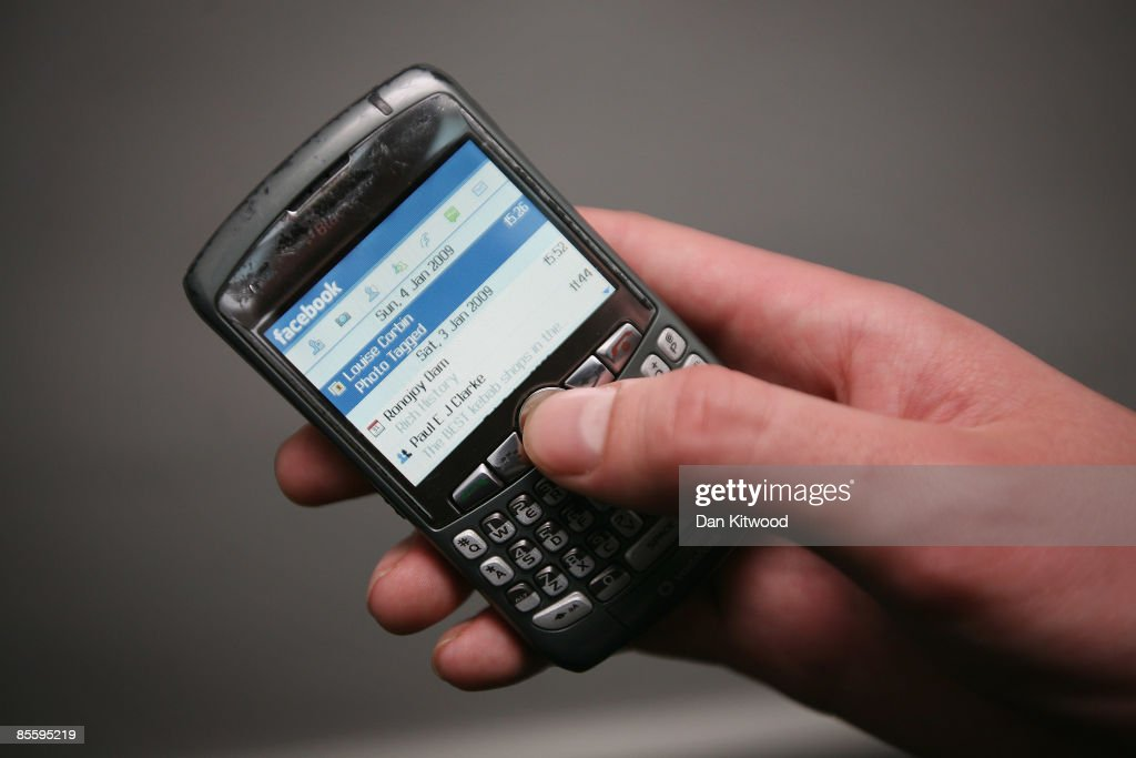 In this photo illustration the Social networking site Facebook is displayed on a mobile phone on March 25, 2009 in London, England. The British government has made proposals which would force Social networking websites such as Facebook to pass on details of users, friends and contacts to help fight terrorism.