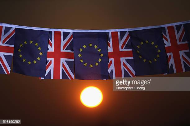 In this photo illustration the sun sets behind European Union and the Union flag bunting on March 17 2016 in Knutsford United Kingdom The United...