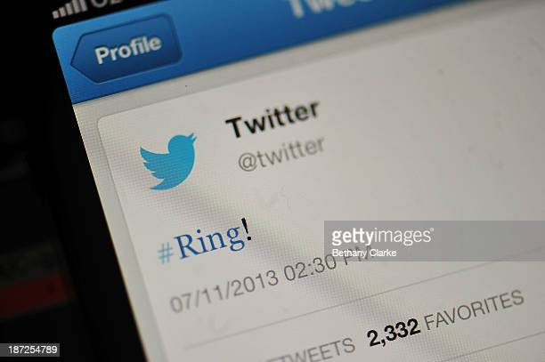 In this photo illustration the Twitter logo and hashtag '#Ring' is displayed on a mobile device as the company announced its initial public offering...