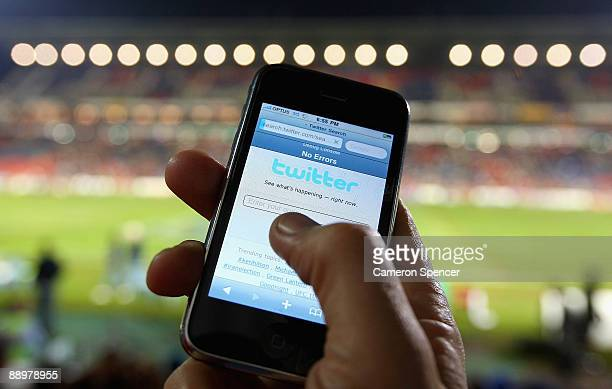 In this photo illustration the Twitter website is displayed on a mobile phone at a NRL match on July 11 2009 in Newcastle Australia The microblogging...