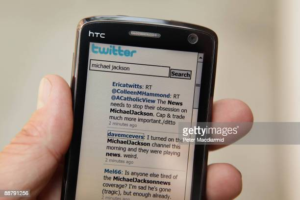 In this photo illustration the Twitter website is displayed on a mobile phone on July 2 2009 in London The social network site started in 2006 in...
