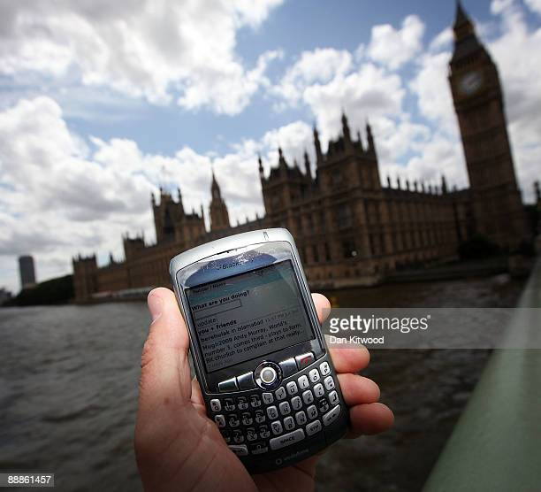 In this photo illustration the Twitter website is displayed on a mobile phone near the Houses of Parliament on July 6 2009 in London The social...