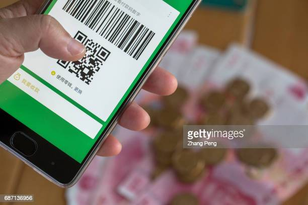 WeChat payment on mobile phone arranged for photography Latest data shows that in the first quarter of 2017 WeChat payment accounted for 3951% of the...