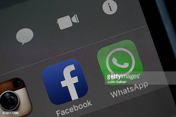 In this photo illustration the WhatsApp application is displayed on a iPhone on April 6 2016 in San Anselmo California Facebookowned mobile mobile...