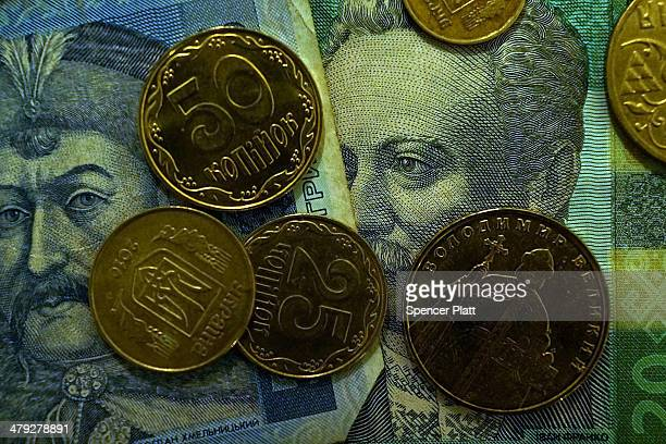 In this photo illustration Ukrainian historical figures are viewed on Ukrainian bank notes on March 17 2014 in Simferopol Ukraine Voters on the...