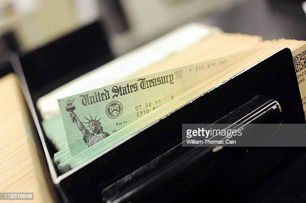 In this photo illustration US Treasury checks are piled at the US Treasury printing facility July 18 2011 in Philadelphia Pennsylvania President...