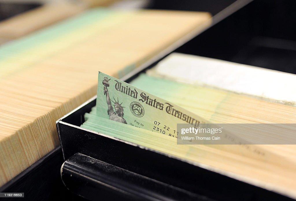 In this photo illustration US Treasury checks are piled at the US Treasury printing facility July 18 2011 in Philadelphia Pennsylvania President...