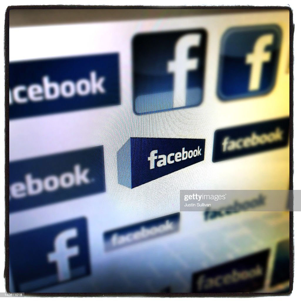 In this photo illustration various Facebook logos are seen on a computer screen on April 9 2012 in New York City Facebook Inc is acquiring...