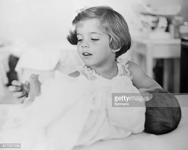 In this photo one of a series released by the White House February 13th Caroline Kennedy daughter of the President plays with the toes of her new...