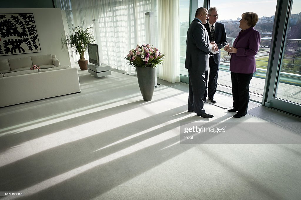 In this photo provided by German Government Press Office German Chancellor <a gi-track='captionPersonalityLinkClicked' href=/galleries/search?phrase=Angela+Merkel&family=editorial&specificpeople=202161 ng-click='$event.stopPropagation()'>Angela Merkel</a> and Bulgarian Prime Minister <a gi-track='captionPersonalityLinkClicked' href=/galleries/search?phrase=Boyko+Borisov&family=editorial&specificpeople=5906164 ng-click='$event.stopPropagation()'>Boyko Borisov</a> (L) talk as their interpreter helps during a bilateral meeting at the Chancellery on January 18, 2012 in Berlin Germany. Bulgaria will seek support from Germany for decreasing the percentage of its national co-financing of EU fund projects.