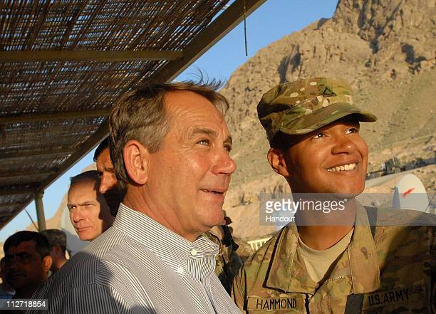 In this photo provided by ISAF Regional Command US Speaker of the House John Boehner poses for a photo with an Ohio soldier April 20 2011 during a...