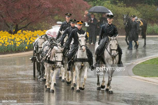 In this photo provided by NASA a horse drawn caisson carries former astronaut and US Senator John Glenn to his final resting place during the...