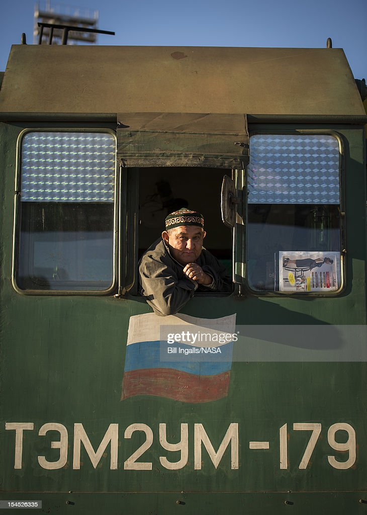 In this photo provided by NASA, A railroad engineer looks out from the locomotive that is used to deliver the Soyuz rocket to the launch pad, on October 21, 2012 at the Baikonur Cosmodrome in Kazakhstan. Launch of the Soyuz rocket is scheduled for October 23 and will send Expedition 33/34 Flight Engineer Kevin Ford of NASA, Soyuz Commander Oleg Novitskiy and Flight Engineer Evgeny Tarelkin of ROSCOSMOS on a five-month mission aboard the International Space Station.