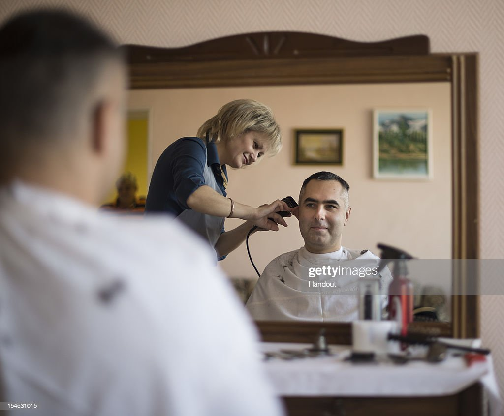 In this photo provided by NASA, Expedition 33 Flight Engineer Evgeny Tarelkin gets his hair cut at the Cosmonaut Hotel, on October 21, 2012 at the Baikonur Cosmodrome in Kazakhstan. Launch of the Soyuz rocket is scheduled for October 23 and will send Expedition 33/34 Flight Engineer Kevin Ford of NASA, Soyuz Commander Oleg Novitskiy and Flight Engineer Engineer Evgeny Tarelkin of ROSCOSMOS on a five-month mission aboard the International Space Station.