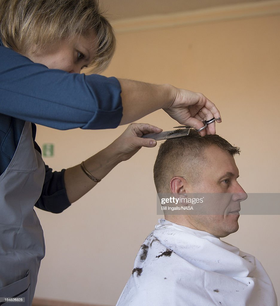 In this photo provided by NASA, Expedition 33 Soyuz Commander Oleg Novitskiy gets his hair cut at the Cosmonaut Hotel, on October 21, 2012 at the Baikonur Cosmodrome in Kazakhstan. Launch of the Soyuz rocket is scheduled for October 23 and will send Expedition 33/34 Flight Engineer Kevin Ford of NASA, Soyuz Commander Oleg Novitskiy and Flight Engineer Evgeny Tarelkin of ROSCOSMOS on a five-month mission aboard the International Space Station.