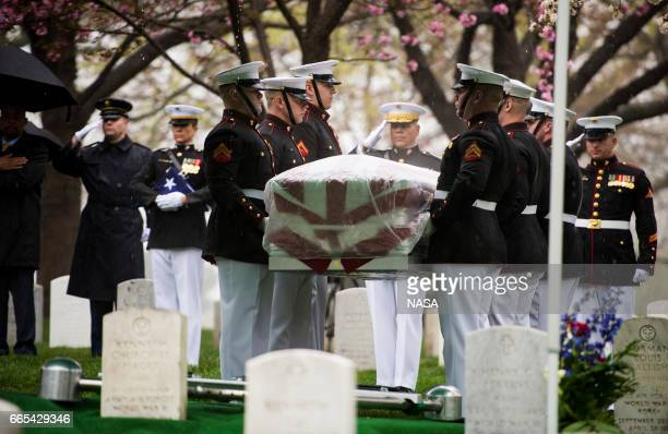 In this photo provided by NASA Marine Corp pallbearers carry former astronaut and US Senator John Glenn to be laid to rest at Arlington National...