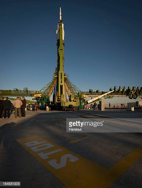 In this photo provided by NASA The Soyuz rocket is erected into position after being rolled out to the launch pad by train on October 21 2012 at the...